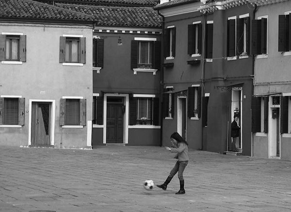 Sprouts #15 by Jeremy Chin - Girl Kicks A Football in Venice, Italy
